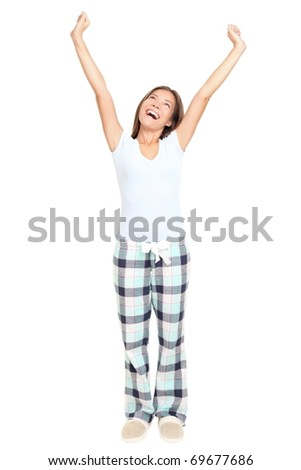 Woman morning stretching in pajamas smiling isolated on white background in full length. Mixed race Asian / Caucasian female model. - stock photo