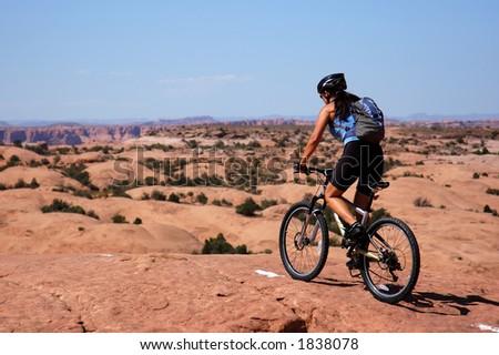 Woman mountain biking in Moab - stock photo