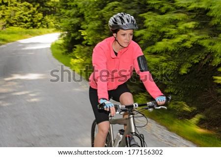 Woman mountain biking motion blur cycling path training race - stock photo