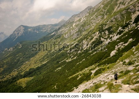 Woman mountainering in alps - stock photo