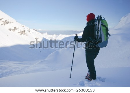 Woman mountainering in high alps in winter