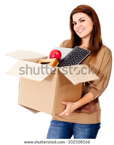 Woman moving house and holding a box - isolated over a white background - stock photo