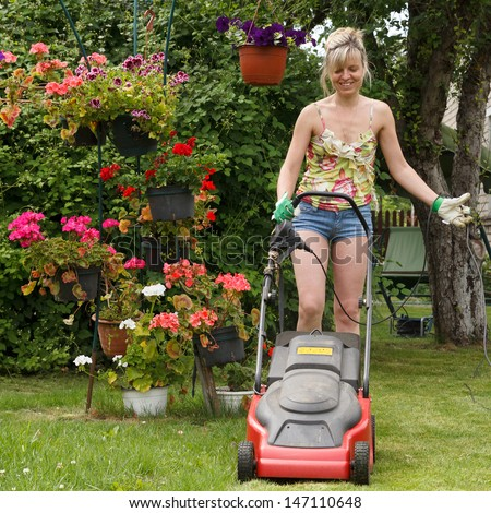 Woman Mows Lawn Electric Lawn Mower Stock Photo 147110648