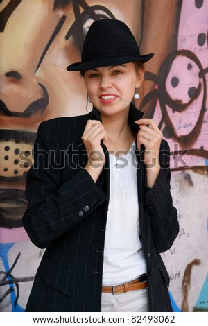 Woman near color wall - stock photo