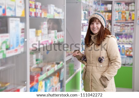 Woman near counter in pharmacy drugstore