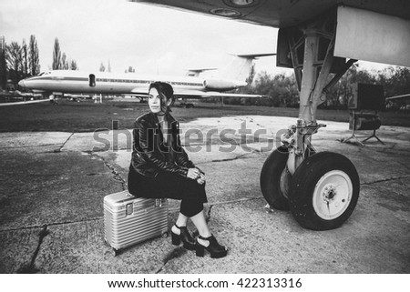 Woman near the aircraft. Journey.Poster. Postcard Background Design / Travel - stock photo