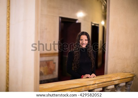 Woman next to the railing of a theater