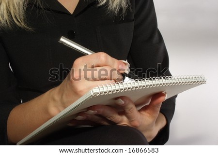 Woman noting something on a piece of paper. See more of my