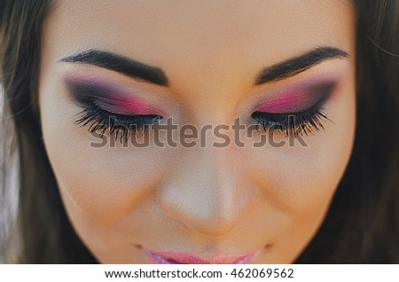 Woman of the Korean race, close. Pink shadows, beautiful eyes. Make-up
