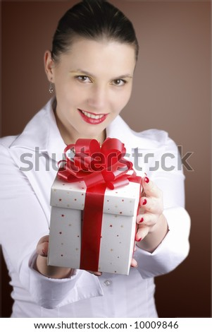 woman offering a gift smiling