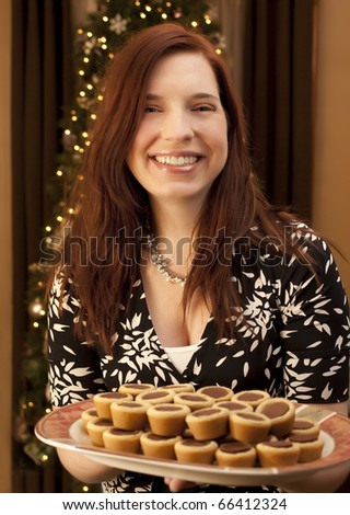 woman offering holiday treats - stock photo