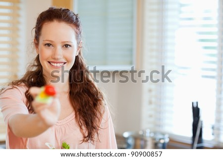 Woman offering some healthy salad