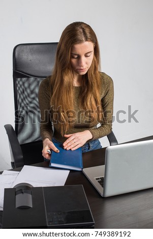 woman office business sitting at table with notebook and multimedia projector