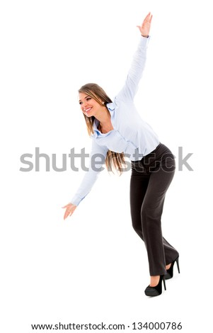 Woman on a business trip simulating an airplane - isolated over white