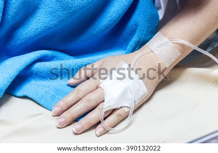 Woman on a drip receiving a saline solution in hospital