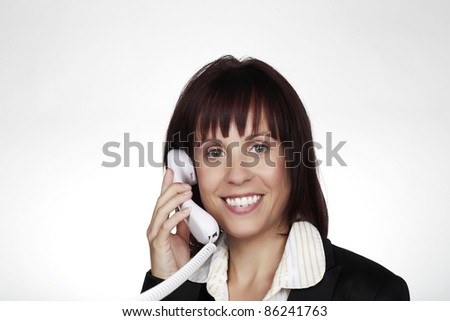 woman on a land line phone talking to someone