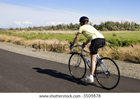 Woman on a Road Bike in Eastern Washington State - stock photo
