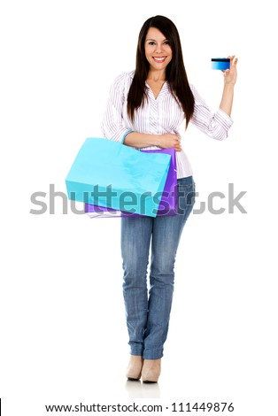 Woman on a shopping spree holding credit card - isolated over white - stock photo