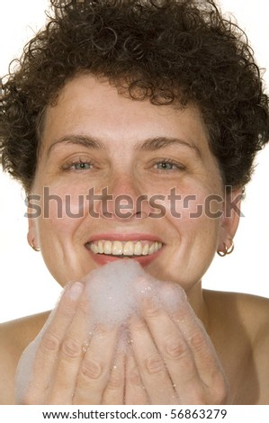 woman on a white background washes foam