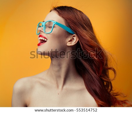 woman on an orange background smiles