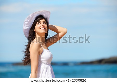 Woman on beach summer vacation. Relaxed girl enjoying summertime leisure and recreational walk. - stock photo
