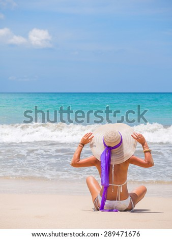 woman on beach with  and hat in virgin islands - stock photo