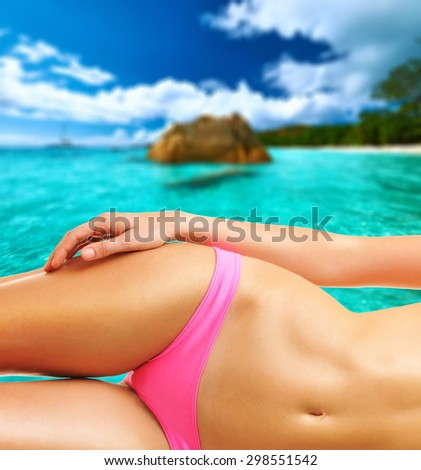 Woman on beautiful beach at Seychelles, Praslin, Anse Lazio. Collage. - stock photo