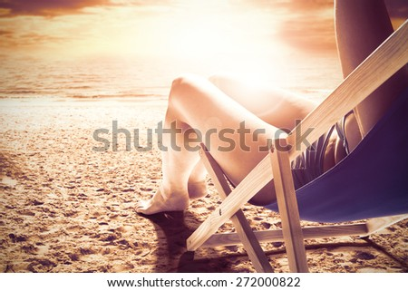 woman on chair and sunset