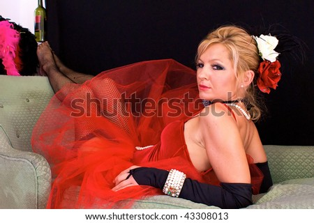 woman on chaise lounge. - stock photo