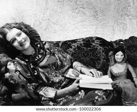 Woman on couch with dolls