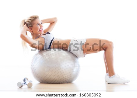 Woman on fitness ball  - stock photo