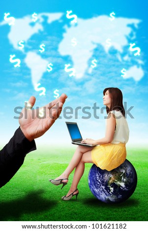 Woman on globe look at the money icon from the Hand : Elements of this image furnished by NASA - stock photo