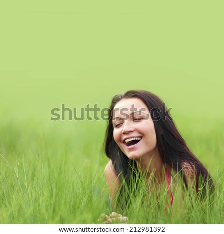 woman on grass in green fields - stock photo