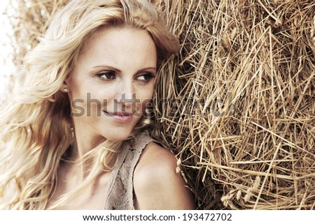 woman on hay close up portrait - stock photo