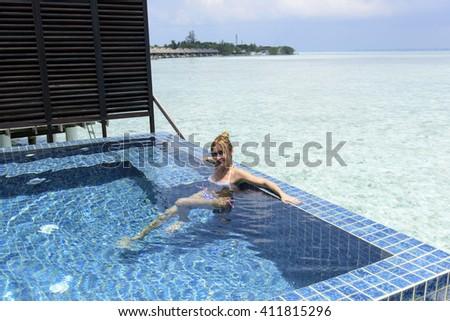 Woman on luxury beach resort - stock photo
