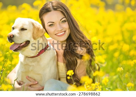 Woman on nature with a dog - stock photo
