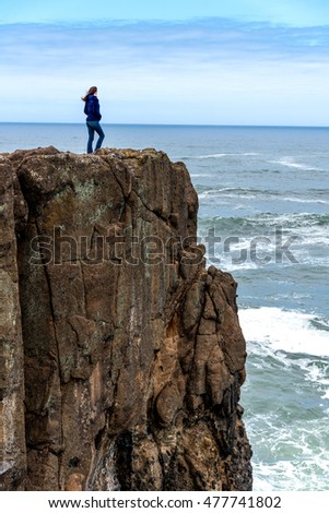 woman on Oregon ocean cliff 2