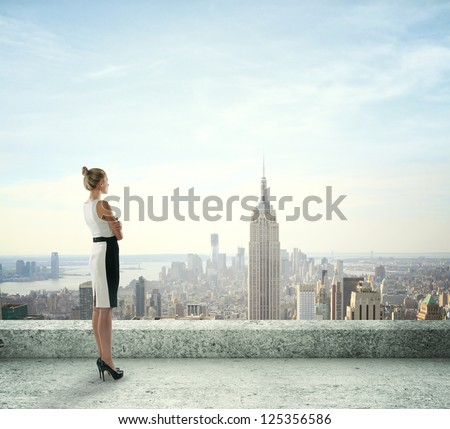woman on roof looking at city - stock photo