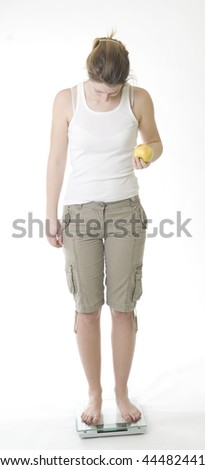 Woman on scale - stock photo
