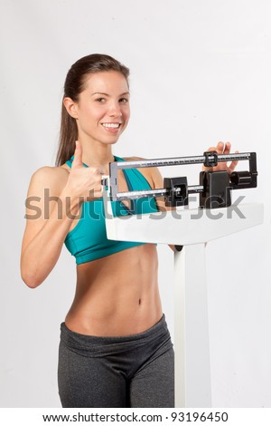 Woman on scale happy with weight