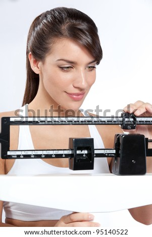Woman on Scale Happy with weight - stock photo