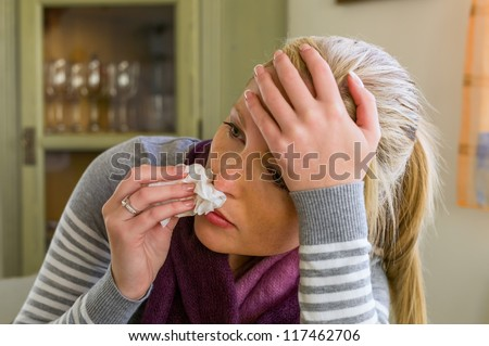 woman on sick leave with a handkerchief and drugs. cold, cold and flu season - stock photo