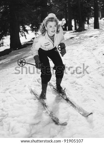 Woman on skis with knees bent - stock photo