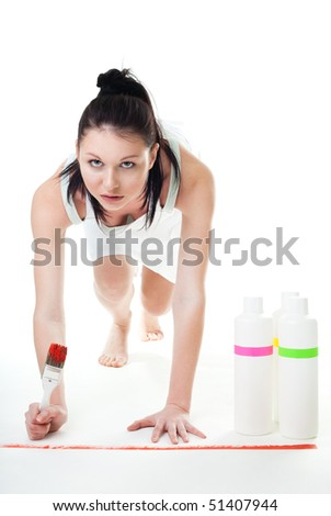 Woman on start line in painting competition holding brush, isolated - stock photo