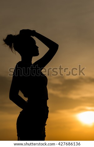 Woman on sunset scape