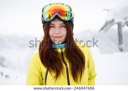Woman on the background of snow winter and mounts - stock photo