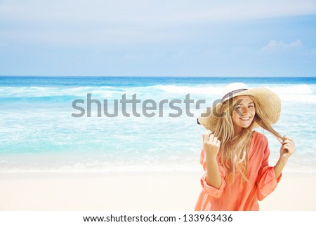 woman on the beach in pink shirt - stock photo