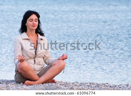 Woman on the beach relaxing - stock photo
