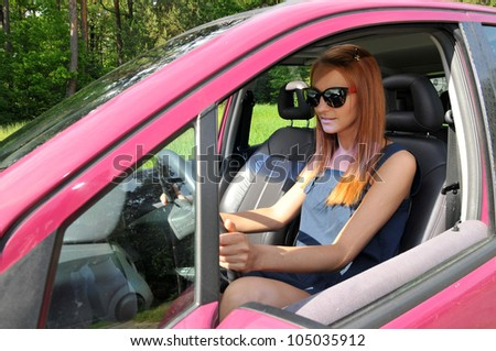 Woman on the car - stock photo