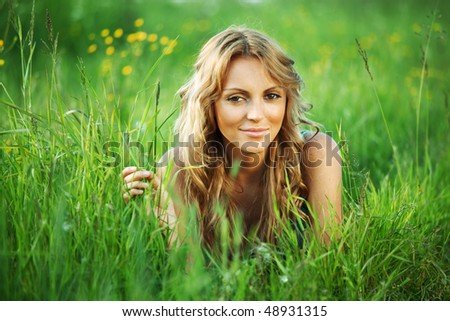 woman on the green grass - stock photo